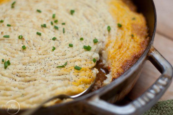Healthy Shepherds Pie in pan with spoon