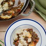 Healthy Shepherds Pie in bowl with Healthy Shepherds Pie in pan with spoon